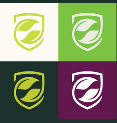 Shield green leaf logo vector
