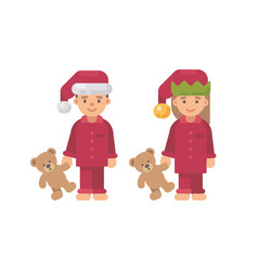 two children in christmas hats and red pajamas vector image