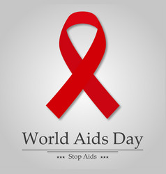 aids day ribbon with shadow text vector image