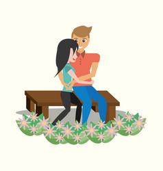 Couple sitting lovely embracing garden vector
