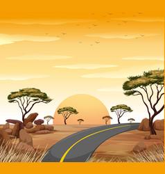 Savanna scene with empty road at sunset vector