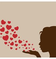 Woman blowing heart vector