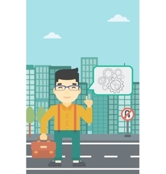Businessman pointing at cogwheels vector