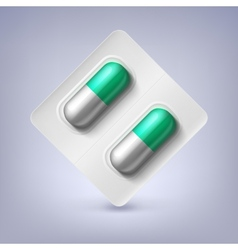 Green and white capsules in a blister pack vector image