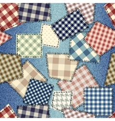Patchwork on denim fabric vector