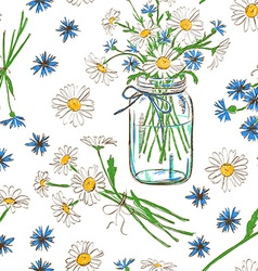 Seamless pattern with chamomile and cornflowers vector