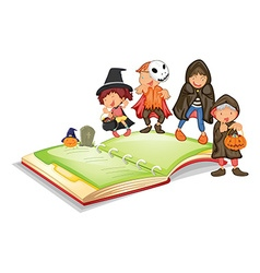 Children in halloween costume and a book vector