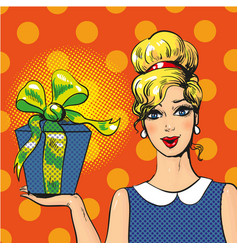 Woman holding gift box pop art vector