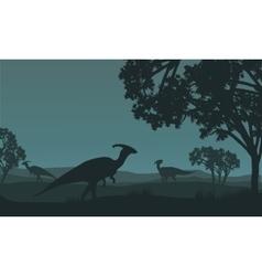 Silhouette of parasaurolophus walking in fields vector