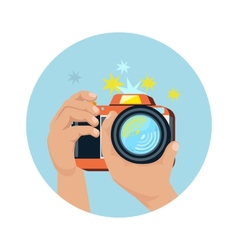 Hands holding camera and photographing vector