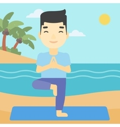 Man practicing yoga tree pose on the beach vector image