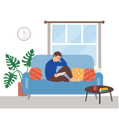 Man sitting on couch and using his tablet vector