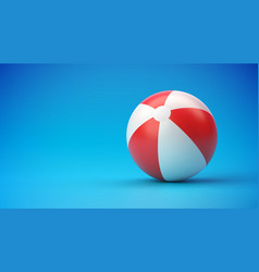 red and white beach ball on blue gradient vector image