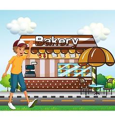 A boy walking across the bakery vector