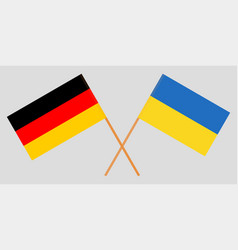 Crossed flags ukraine and germany vector