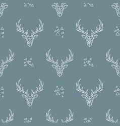 Deer pattern on dark blue background seamless vector