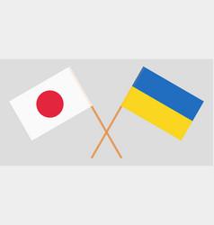 Crossed ukraine and japan flags vector