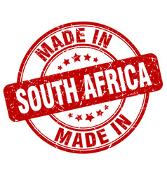 made in south africa red grunge round stamp vector image