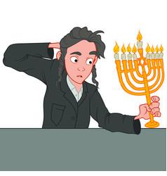 Young jewish boy celebrating hanukkah holding the vector