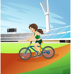 A girl biking at the field vector