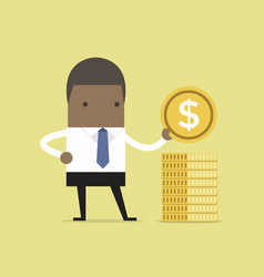 african businessman puts gold coin in a pile vector image