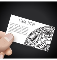 Hand with business card in ethnic style vector image