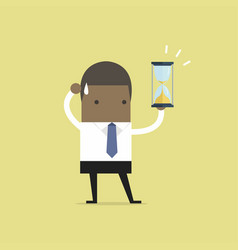african businessman holding sandglass or hourglass vector image