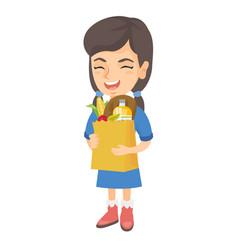 Girl holding paper shopping bag full of groceries vector