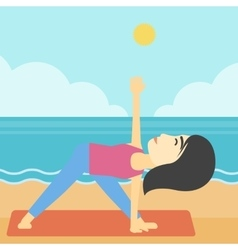 Woman practicing yoga triangle pose on the beach vector image