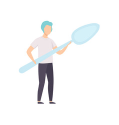 Young man standing with a giant spoon faceless vector
