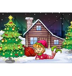 A female Santa elf near the christmas tree vector