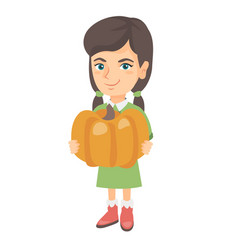 caucasian girl standing with a big orange pumpkin vector image