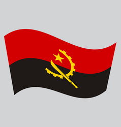 flag of angola waving on gray background vector image
