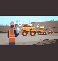 Open pit man worker in helmet using mobile app vector