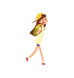 Happy girl walking with backpack vector
