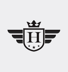 letter h shield wing vector image