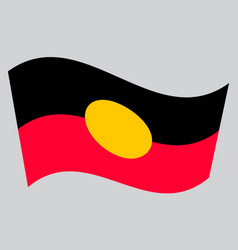 Australian aboriginal flag waving gray background vector