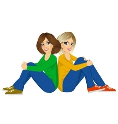 Attractive women sitting back to back vector