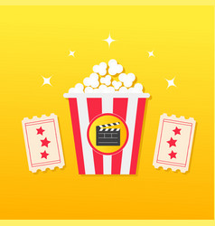 popcorn box two tickets with stars clapper board vector image