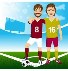 Two young soccer players friends vector