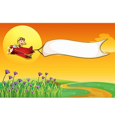 An airship with a monkey and a white banner vector