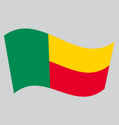 flag of benin waving on gray background vector image vector image
