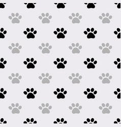Seamless pattern with paws footprints vector