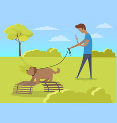 young boy walking with dog and using phone in park vector image