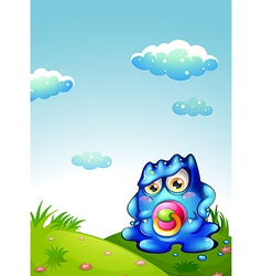 A baby blue monster at the hilltop vector image