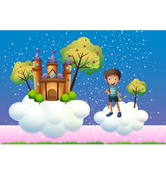 A boy and a floating castle vector image