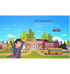 Boy raising hands yellow bus school building vector