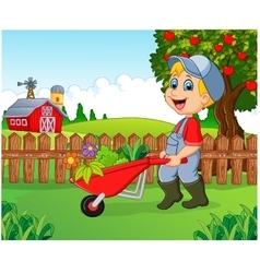 Cartoon little boy holding wheelbarrow vector image