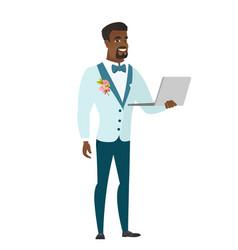 groom using laptop vector image