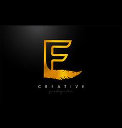 E golden gold feather letter logo icon design vector